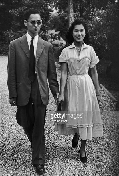 King Bhumibol Adulyadej of Thailand with his fiancee Sirikit Kitiyakara, 14th January 1950. Original Publication : Picture Post - A King's Fiancee -...