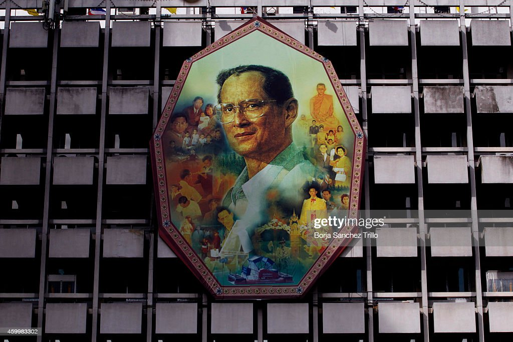 A King Bhumibol Adulyadej portrait is seen at Siriraj Hospital on December 5, 2014 in Bangkok, Thailand. Thailand celebrates their King's 87th Birthday as King Bhumibol Adulyadej remains in the hospital where he's spent the last few months. He has cancelled his public appearance in the capital to mark the traditional celebration due to the doctors medical advice who said he wasn't well enough to attend.