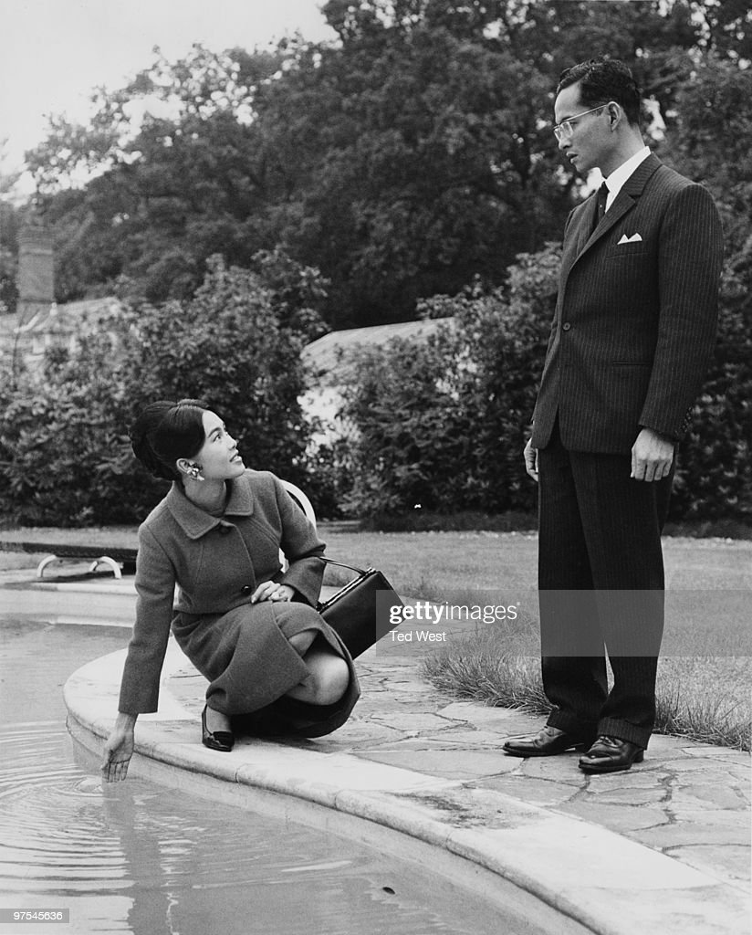 King Bhumibol and Queen Sirikit of Thailand bid farewell to King's Beeches, the house in Sunninghill, Berkshire, where they and their children have spent the summer, 4th October 1966.