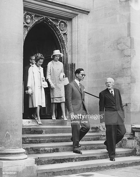 King Bhumibol and Queen Sirikit of Thailand leave Trinity Hall Trinity College Cambridge during their state visit to England 21st July 1960 They are...