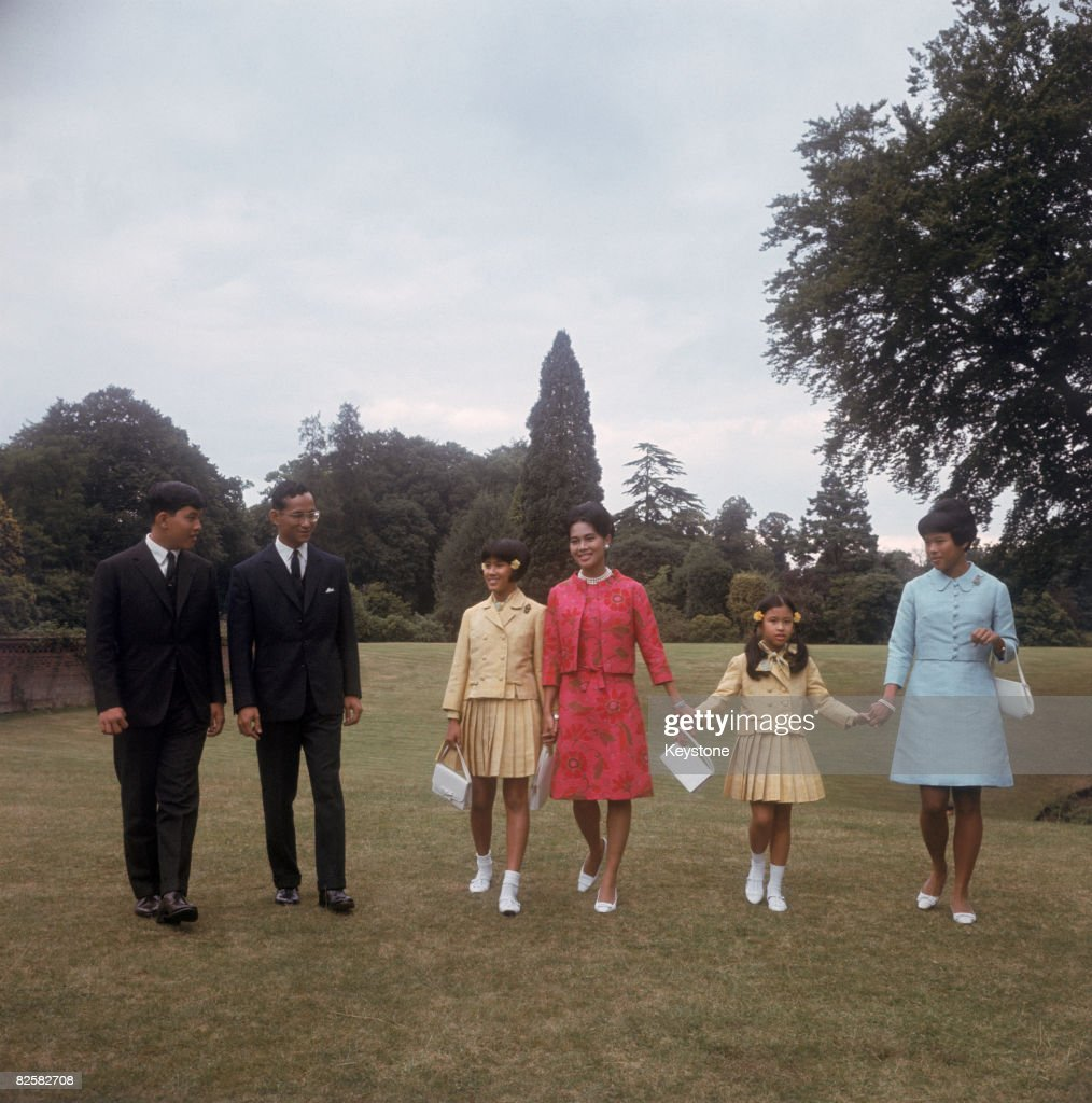 King Bhumibol and Queen Sirikit of Thailand with their children at King's Beeches, their private residence in Sunninghill, Berkshire, 27th July 1966. From left to right, Crown Prince Maha Vajiralongkorn, the King, Princess Sirindhorn, the Queen, Princess Chulabhorn and Princess Ubol Ratana.