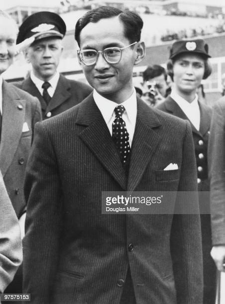 King Bhumibol of Thailand arrives at London Airport at the end of his state visit to England, 23rd July 1960. He is travelling to Switzerland to...