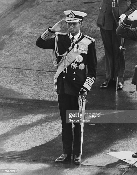 King Bhumibol of Thailand performs a smart salute upon exiting his aircraft at Gatwick Airport 19th July 1960 He and Queen Sirikit were met at the...