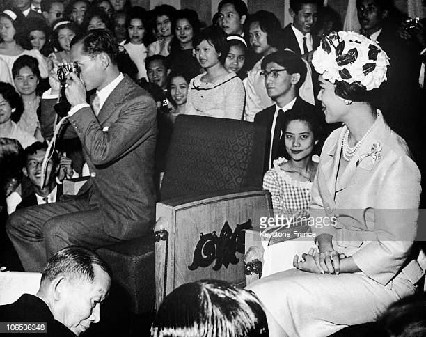 King Bhumibol Taking A Picture And Queen Sirikit On A Party Organized At The Embassy Of Thailand In London