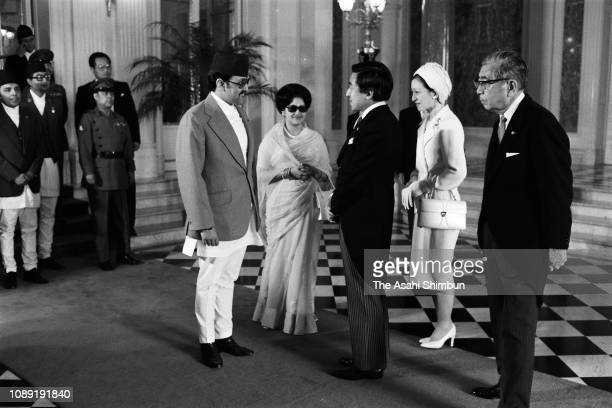 King Birendra and Queen Aishwarya of Nepal greet Crown Prince Akihito and Crown Princess Michiko prior to the welcome ceremony at the Akasaka State...