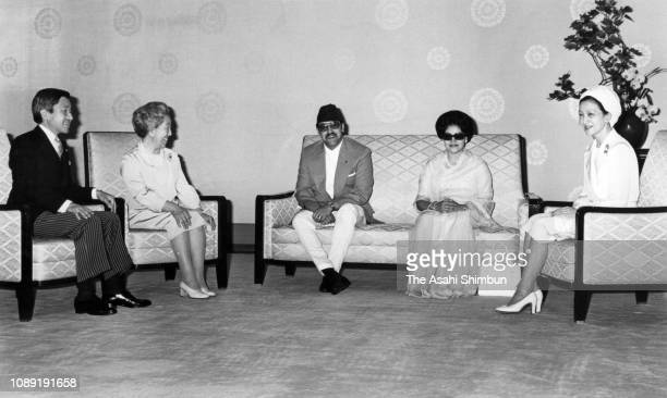 King Birendra and Queen Aishwarya of Nepal talk with Empress Nagako Crown Prince Akihito and Crown Princess Michiko during their meeting at the...