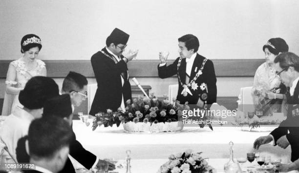 King Birendra and Queen Aishwarya of Nepal toast glasses with Crown Prince Akihito and Crown Princess Michiko during state dinner at the Imperial...