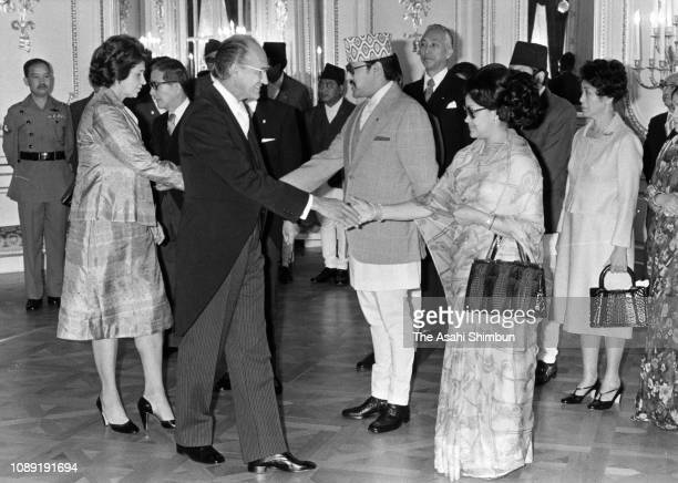 King Birendra and Queen Aishwarya of Nepal welcome guests prior to the return reception at the Akasaka State Guest House on May 18 1978 in Tokyo Japan