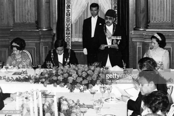 King Birendra of Nepal addresses while Queen Aishwarya of Nepal Crown Prince Akihito and Crown Princess Michiko listen during the return reception at...