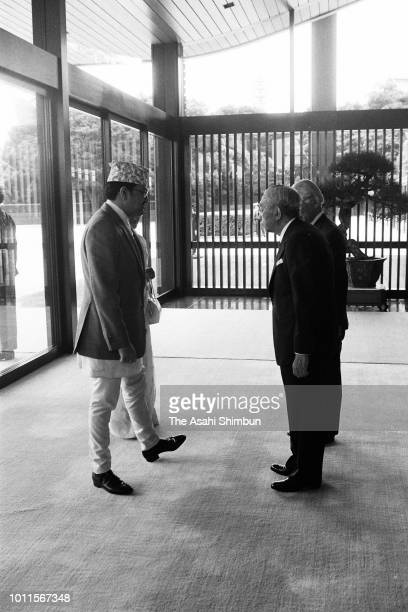 King Birendra of Nepal and Queen Aishwarya of Nepal are welcomed by Emperor Hirohito prior to their meeting at the Imperial Palace on September 13...