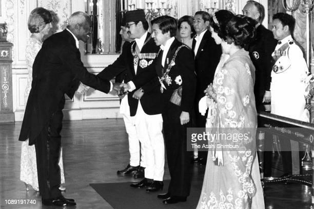King Birendra Queen Aishwarya of Nepal Crown Prince Akihito and Crown Princess Michiko welcome guests prior to the return reception at the Akasaka...