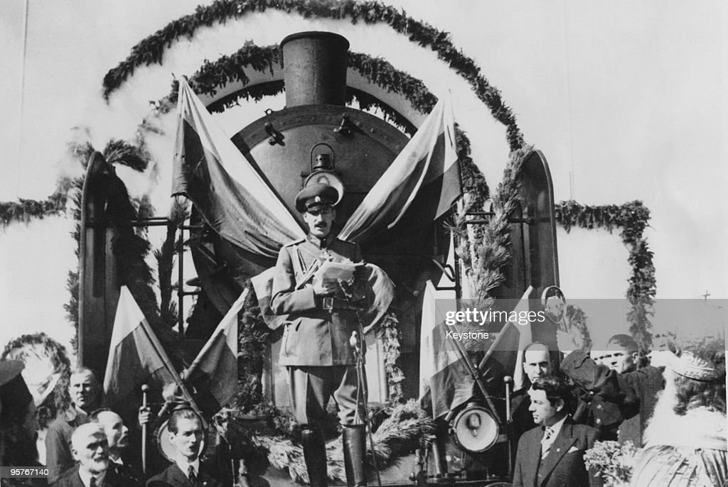 King Boris III of Bulgaria (1894 - 1943) makes a speech after driving the engine of the first train on a new railway line from Dupnitsa to Gorna Dzhumaya (later Blagoevgrad) in western Bulgaria, 17th October 1937. The 20-mile long line cost the equivalent of 120,000 pounds sterling.