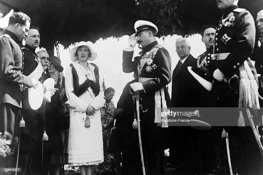 King Boris III (1894 - 1943) of the Bulgarians, and his wife, Queen Ioanna, formerly Princess Giovanna of Italy (1907 - 2000) in Bulgaria. The man to the left of the Queen, with the white sash across a black uniform is the King's younger brother, Prince Kiril (1895 -1945).