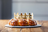 King Cake or King Bread, called in German language Dreikönigskuchen, baked in Switzerland on January 6th. Small plastic miniature of the king is hidden inside of the bread. The person who finds it, is called the king of the day.