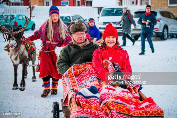 King Carl Gustaf of Sweden and Queen Silvia take a reindeer sledge ride as they visit the 400 year old Jokkmokk Fair in Jokkmokk, northerns Sweden on...