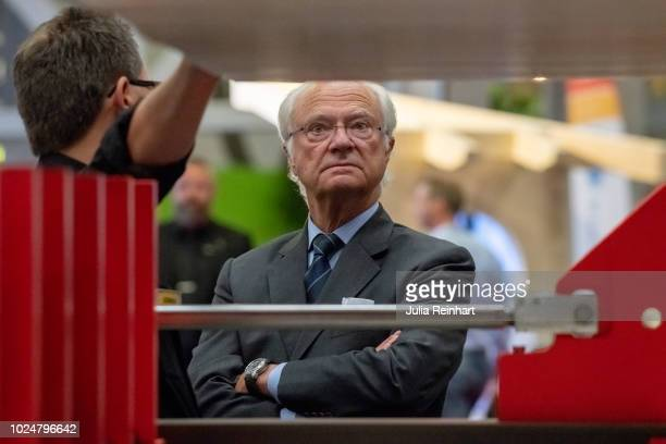 King Carl Gustaf Of Sweden inspects a saw machine during his visit to The Wood and Technology Trade Fair at Svenska Mässan on August 28 2018 in...
