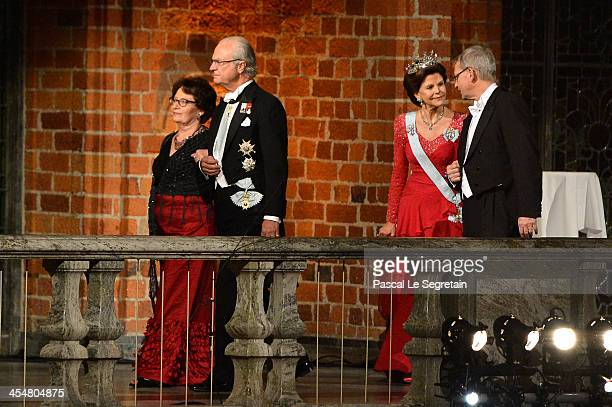 King Carl Gustaf XIV of Sweden and his dinner companion Queen Silvia of Sweden and Chairman of the Board of the Nobel Foundation Professor CarlHenrik...
