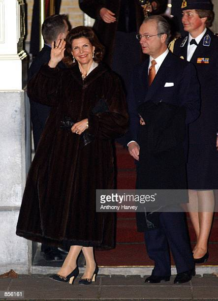 King Carl Gustav and Queen Sylvia of Sweden are on the way to wedding celebrations February 1 2002 in Amsterdam Netherlands for Dutch Crown Prince...