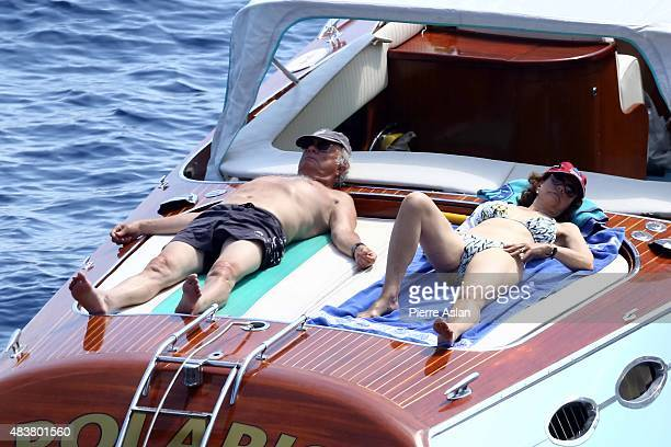 King Carl Gustav and Queen Sylvia of Sweden resting on their speed boat and enjoying their holidays