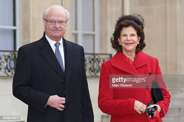 King Carl Gustav of Sweden and Queen Silvia of Sweden are received by French President Francois Hollande at Elysee Palace on December 2, 2014 in...