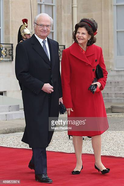 King Carl Gustav of Sweden and Queen Silvia of Sweden are received by French President Francois Hollande at Elysee Palace on December 2 2014 in Paris...