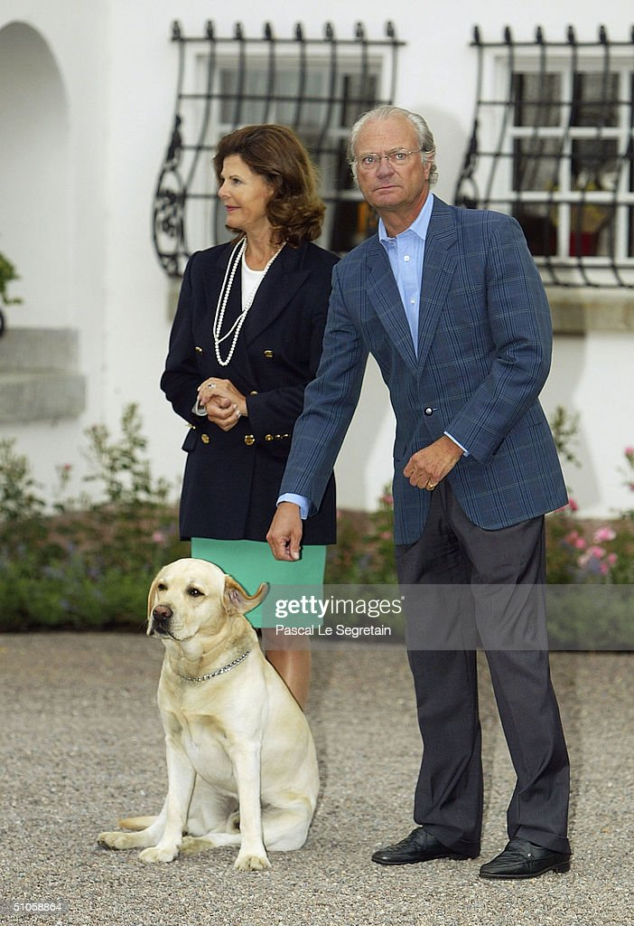 King Carl Gustav (R), Queen Silvia (L) and the dog Bingo attend the celebrations for Crown Princess Victoria of Sweden's 27th birthday, at the Royal family's summer Residence on July 14, 2004 in Borgholm, Sweden.