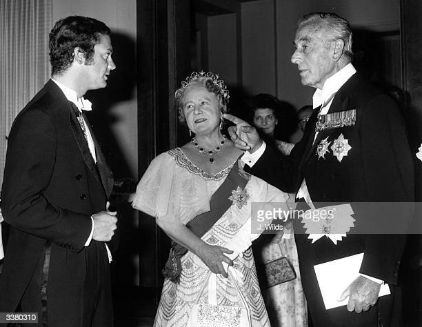 King Carl Gustav XVI of Sweden with Queen Elizabeth the Queen Mother and Earl Mountbatten of Burma at a society party