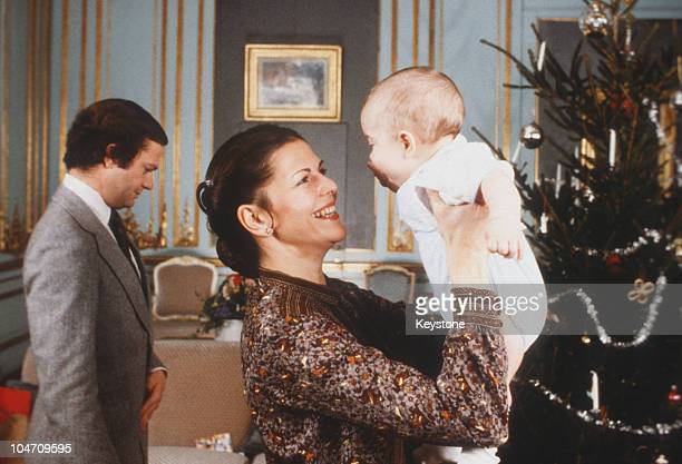 King Carl XVI Gustaf and Queen Silvia of Sweden with their baby son Prince Carl Philip in December 1979