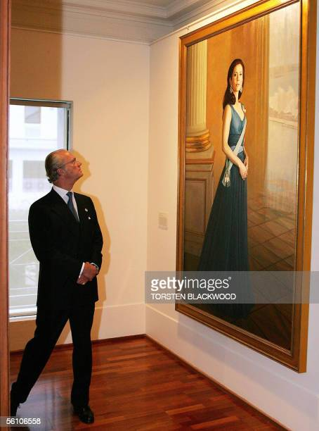 King Carl XVI Gustaf of Sweden admires Jaiwei Shen's portrait of Australianborn Crown Princess Mary of Denmark at the National Portrait Gallery in...