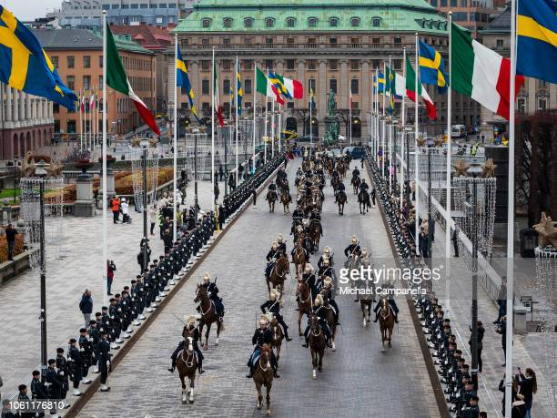King Carl XVI Gustaf of Sweden and Italian president Sergio Mattarella arrive at the Stockholm Royal Palace on November 13 2018 in Stockholm Sweden...