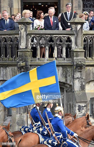 King Carl XVI Gustaf of Sweden and Queen Silvia of Sweden are pictured during a welcoming ceremony on July 11 2016 at the townhall in Aachen / AFP /...