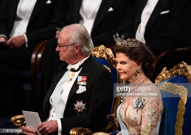 King Carl XVI Gustaf of Sweden and Queen Silvia of Sweden arrive for the Nobel awards ceremony at the Concert Hall in Stockholm Sweden on December 10...