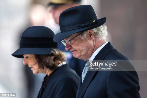 King Carl XVI Gustaf of Sweden and Queen Silvia of Sweden leaving the city of Stockholm's official ceremony for the victims of the recent terrorist...