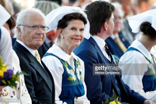King Carl XVI Gustaf of Sweden and Queen Silvia of Sweden participate in a ceremony celebrating Sweden's national day at Skansen on June 06, 2019 in...