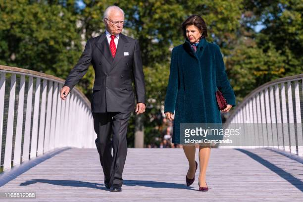 King Carl XVI Gustaf of Sweden and Queen Silvia of Sweden walk across the Folke Bernadotte bridge during the inauguration ceremony on September 17...