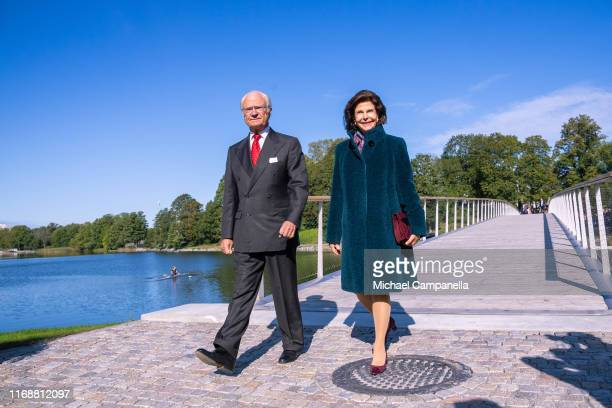 King Carl XVI Gustaf of Sweden and Queen Silvia of Sweden walk across the Folke Bernadotte bridge during the inauguration ceremony on September 17,...