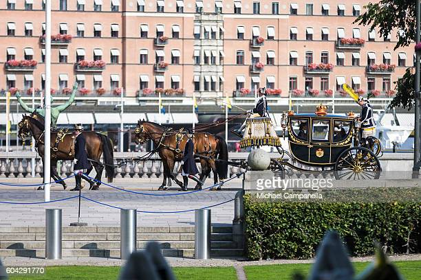 King Carl XVI Gustaf of Sweden arrives by horse and carriage at a ceremony at Riksdag in connection with the opening session of the Swedish...