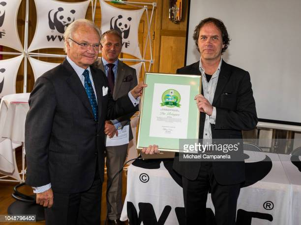 King Carl XVI Gustaf of Sweden awards Par Holmgren with the Environmental Hero of The Year during the WWF's autumn meeting at Ulriksdals Palace on...