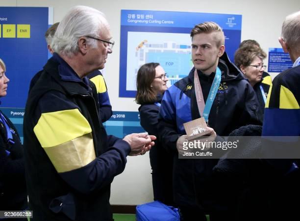 King Carl XVI Gustaf of Sweden congratulates silver medalist Christopher Sundgren of Sweden following the Curling Men's Gold Medal Game between USA...