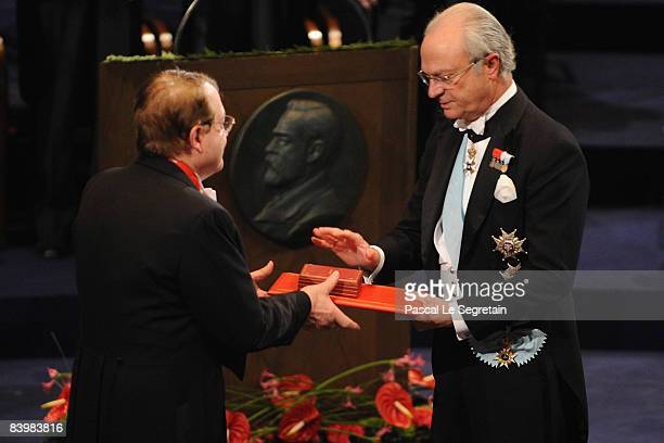 King Carl XVI Gustaf of Sweden gives the 2008 Nobel Prize for Medicine to French scientist Luc Montagnier for his discovery of the virus that causes...