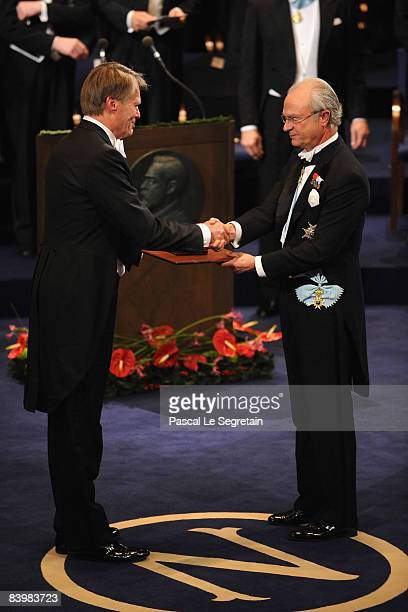 King Carl XVI Gustaf of Sweden hands the 2008 Nobel Prize in Literature to French writer Jean-Marie Gustave Le Clezio during the Nobel Foundation...