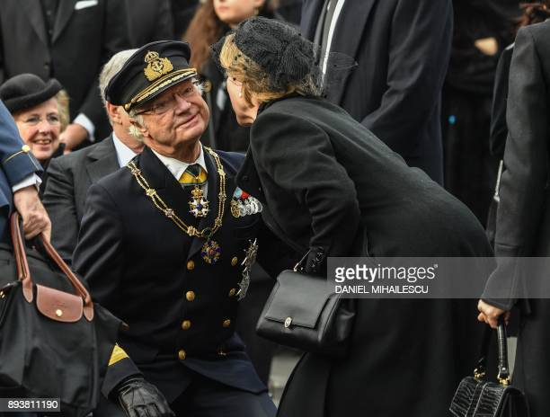 King Carl XVI Gustaf of Sweden is embraced by Queen AnneMarie of Greece at the funeral ceremony for the late King Michael I of Romania inside the...