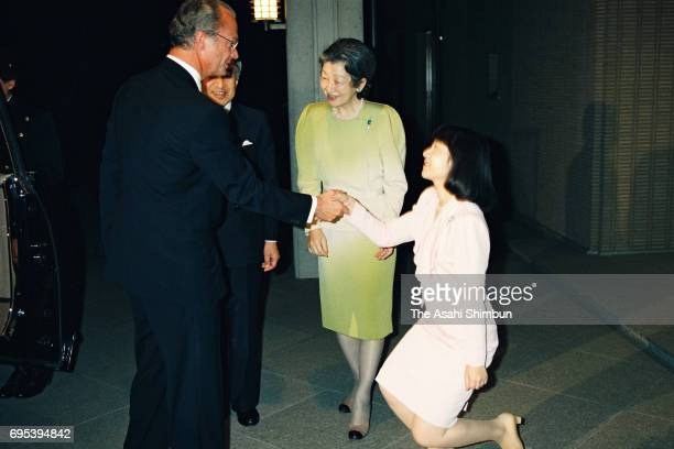 King Carl XVI Gustaf of Sweden is welcomed by Emperor Akihito Empress Michiko and Princess Sayako prior to their dinner at the Imperial Palace on...
