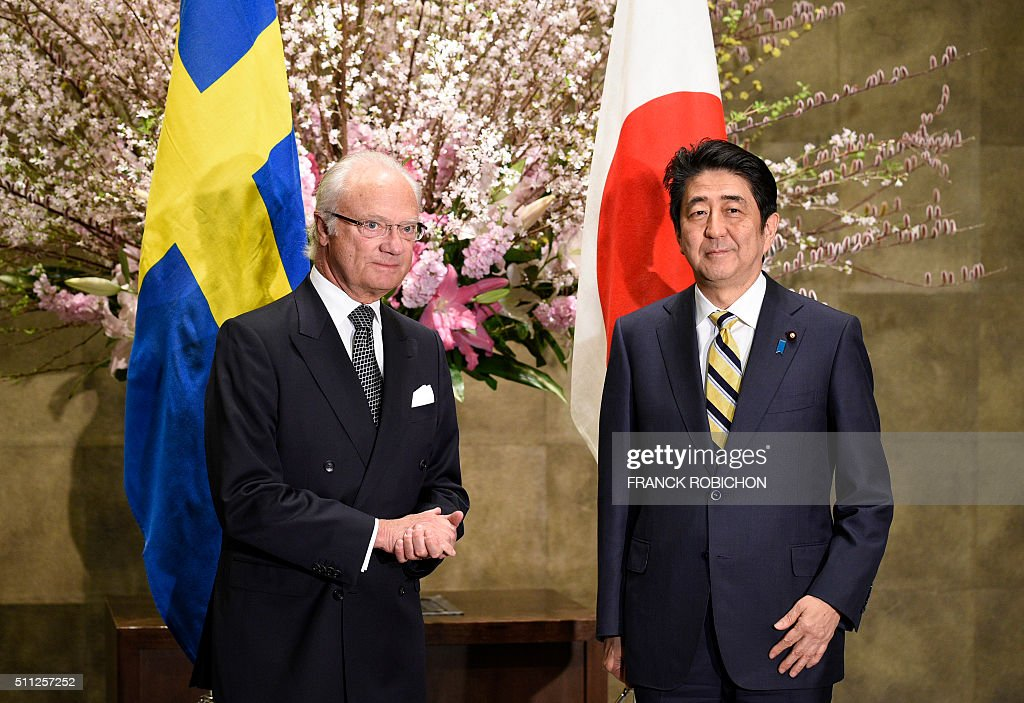 King Carl XVI Gustaf of Sweden (L) is welcomed by Japanese Prime Minister Shinzo Abe prior to their meeting at Abe's official residence in Tokyo on February 19, 2016. King Gustaf is visiting Japan with Royal Swedish Academy of Engineering Sciences members.