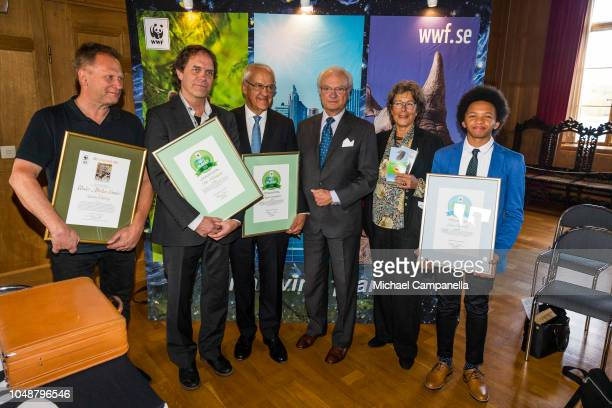 King Carl XVI Gustaf of Sweden poses for a picture with the winners of the Environmental Hero of the Year award during the WWF's autumn meeting at...