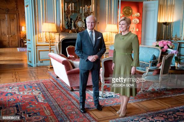 King Carl XVI Gustaf of Sweden poses with Croatia's president Kolinda GrabarKitarovic during her visit at the Royal Palace in Stockholm March 21 2017...