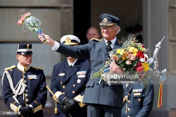 King Carl XVI Gustaf of Sweden poses with flowers and gifts he received at a celebration of his 73rd birthday anniversary at the Royal Palace on...