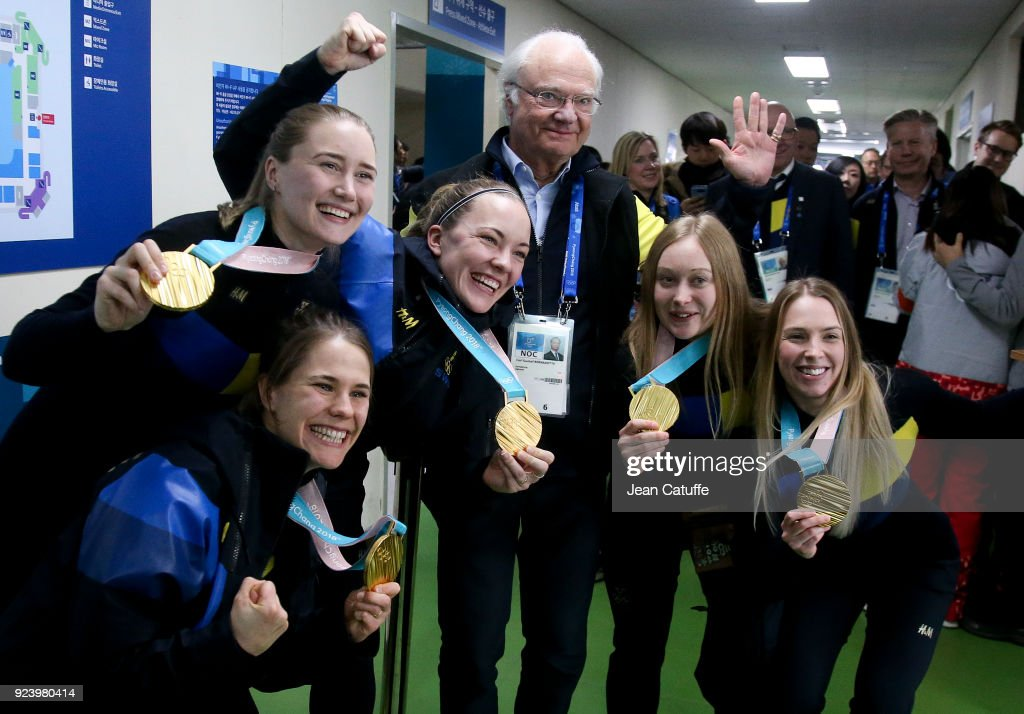 King Carl XVI Gustaf of Sweden poses with gold medalists of Team Sweden Anna Hasselborg, Sara McManus, Agnes Knochenhauer, Jennie Waahlin, Sofia Mabergs following the Curling Women's Gold Medal Game between Sweden and South Korea on day sixteen of the PyeongChang 2018 Winter Olympic Games at Gangneung Curling Centre on February 25, 2018 in Gangneung, Pyeongchang, South Korea.