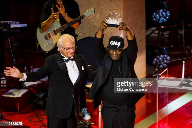 King Carl XVI Gustaf of Sweden presents Grandmaster Flash with his prize during the 2019 Polar Music Prize award ceremony on June 11 2019 in...