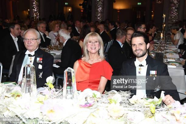 King Carl XVI Gustaf of Sweden Professor Evi Heldin and Prince Carl Phillip of Sweden attend the Nobel Prize Banquet 2017 at City Hall on December 10...